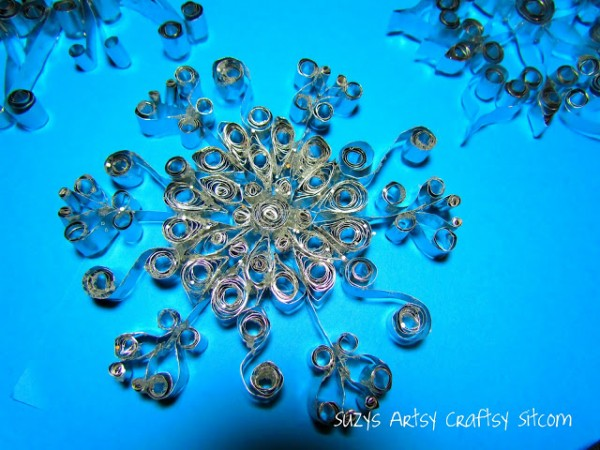 quilled aluminum snowflakes made from disposable cookie sheets
